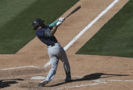 Seattle Mariners' J.P. Crawford hits an RBI-single against the Oakland Athletics during the eighth inning of the first baseball game of a doubleheader in Oakland, Calif., Saturday, Sept. 26, 2020. (AP Photo/Jed Jacobsohn)
