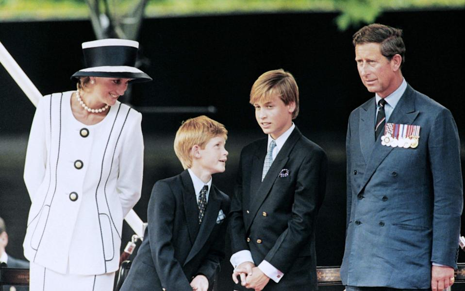 Princess Diana and Prince Charles with their children William and Harry  - AFP