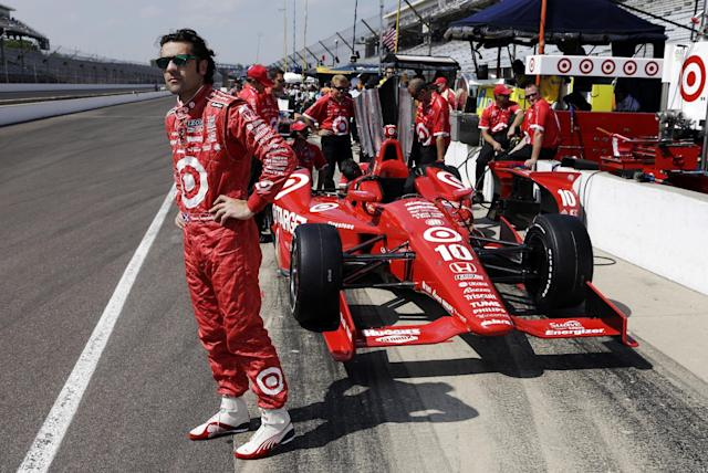 FILE - In this May 19, 2013, file photo, Dario Franchitti, of Scotland, waits next to his car during a break in a practice session on the second day of qualifications for the Indianapolis 500 auto race at the Indianapolis Motor Speedway in Indianapolis. The three-time Indianapolis 500 winner said Thursday, Nov. 14, 2013, that doctors have told him he can no longer race because of injuries sustained in an IndyCar crash last month. He fractured his spine, broke his right ankle and suffered a concussion in the Oct. 6 crash at Houston. (AP Photo/Tom Strattman, File)