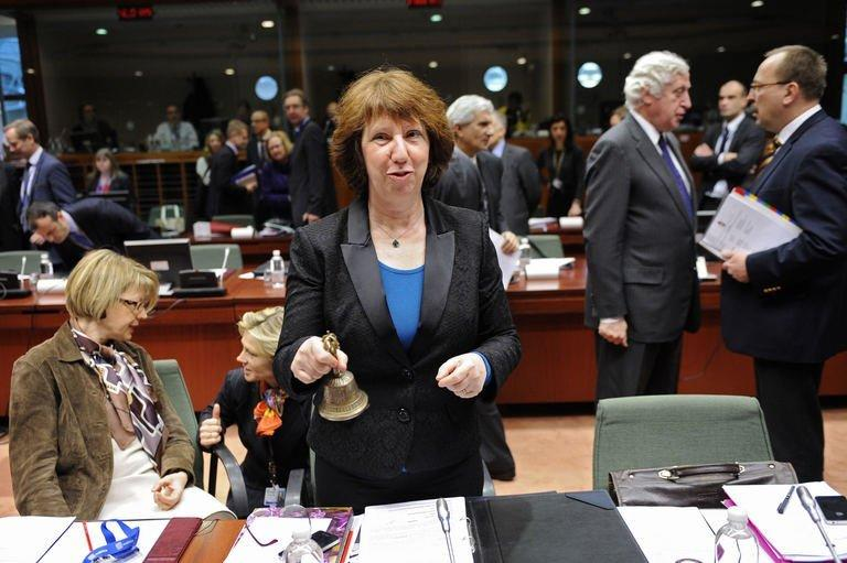 High Representative of the European Union for Foreign Affairs and Security Policy Catherine Ashton rings the bell before a Foreign Affairs Council at the EU Headquarters in Brussels on February 18, 2013