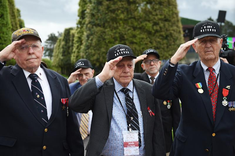 "US veterans Jack Gutman (C), Georges Ciampa (2R) and James Forlking (R), landed on ""Omaha Beach"" on June 6, 1944 (AFP Photo/GUILLAUME SOUVANT)"
