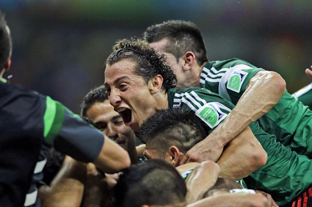 Mexico's Andres Guardado celebrates with teammates after Mexico's Rafael Marquez scored his team's first goal during the group A World Cup soccer match between Croatia and Mexico at the Arena Pernambuco in Recife, Brazil, Monday, June 23, 2014. (AP Photo/Ricardo Mazalan)
