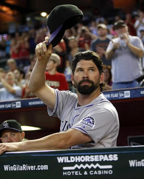 Colorado Rockies first baseman Todd Helton acknowledges the crowd in the second inning of a baseball game against the Arizona Diamondbacks after announcing his retirement at the end of the season on Sunday, Sept. 15, 2013, in Phoenix. (AP Photo/Rick Scuteri)