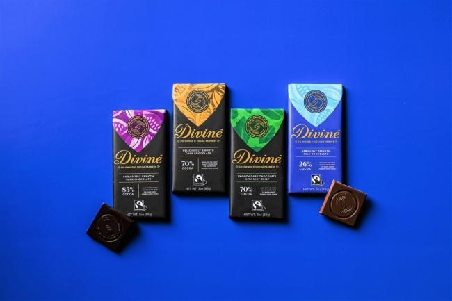 """Divine Chocolate launches new branding, emphasizing the brand's authentic social mission through deep partnership with Fairtrade America and unique """"Co-owned by Cocoa Farmers"""" business model"""