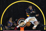 Los Angeles Clippers center Ivica Zubac, right, shoots as Phoenix Suns forward Jae Crowder and center Deandre Ayton, left, defend during the first half of game 2 of the NBA basketball Western Conference Finals, Tuesday, June 22, 2021, in Phoenix. (AP Photo/Matt York)