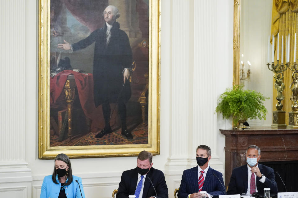 From left, PG&E CEO Patti Poppe, Southern Company CEO Tom Fanning, SJW Group CEO Eric Thornburg, and American Water CEO Walter Lynch attend a meeting about cybersecurity with President Joe Biden in the East Room of the White House, Wednesday, Aug. 25, 2021, in Washington. (AP Photo/Evan Vucci)