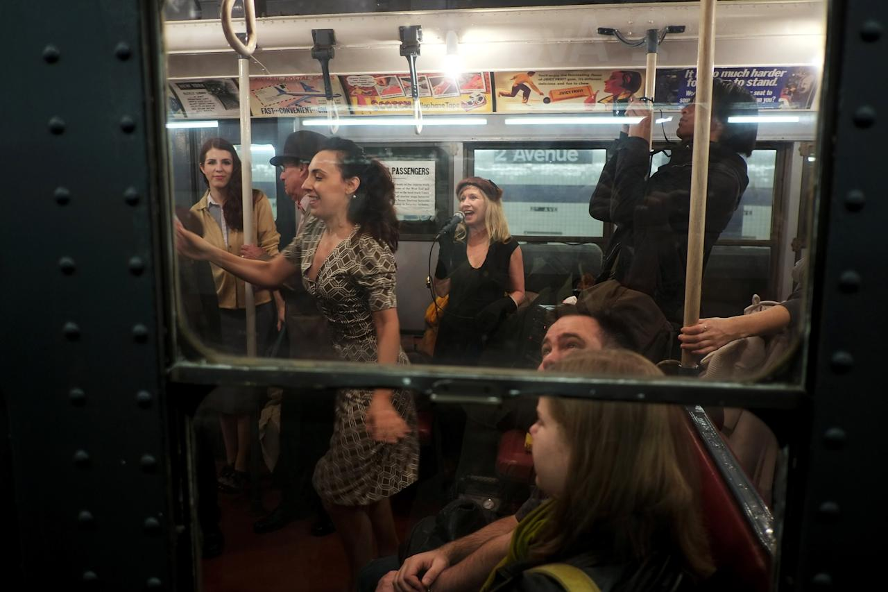 NEW YORK, NY - DECEMBER 16:  People dance to live music in a vintage New York City subway car as it sits in the 2nd Ave. station on December 16, 2012 in New York City. The New York Metropolitan Transportation Authority (MTA) runs vintage subway trains from the 1930's-1970's each Sunday along the M train route from Manhattan to Queens through the first of the year.  (Photo by Preston Rescigno/Getty Images)