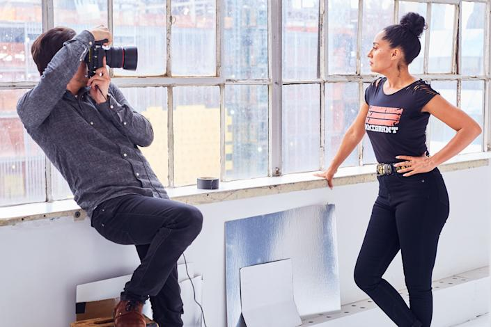 """Actress Tracee Ellis Rossbehind the scenes of the """"I Am An Immigrant"""" photo shoot."""