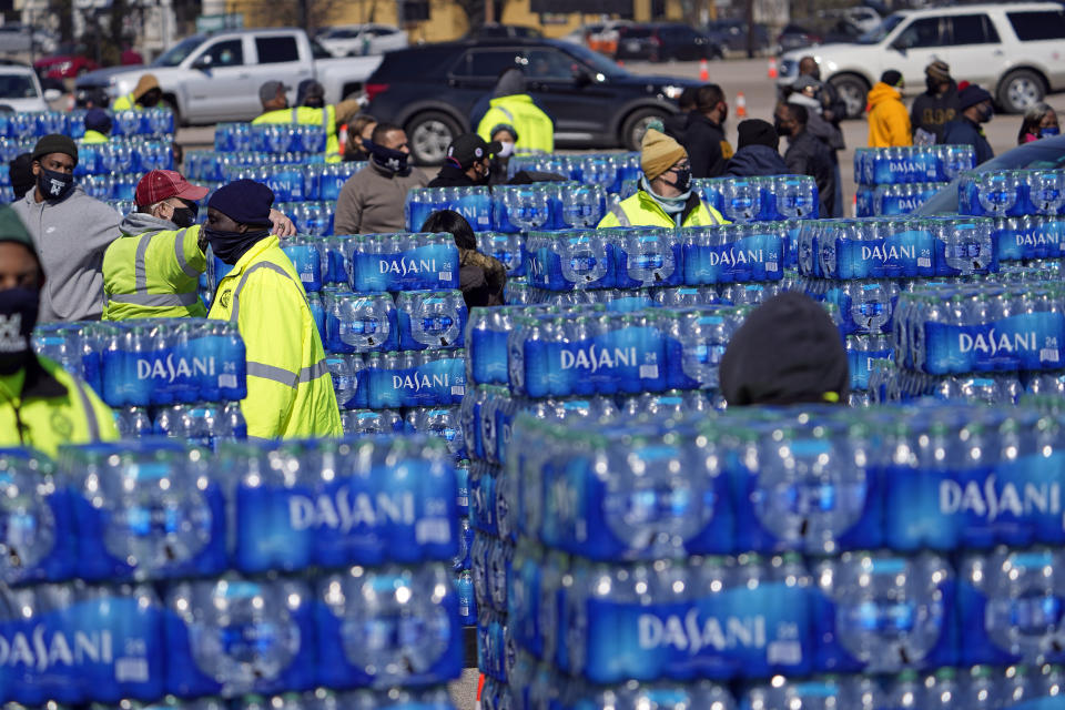 Water to be loaded into vehicles is stacked at a City of Houston water distribution site