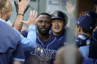 Tampa Bay Rays' Randy Arozarena, center left, is greeted in the dugout after he hit a two-run home run that also scored Ji-Man Choi, center right, during the fourth inning of a baseball game against the Seattle Mariners, Thursday, June 17, 2021, in Seattle. (AP Photo/Ted S. Warren)