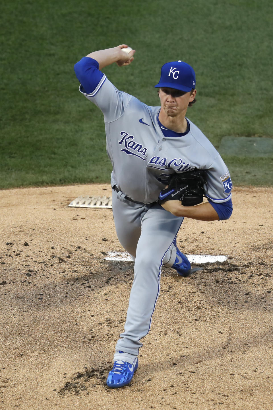 Kansas City Royals starting pitcher Brady Singer delivers during the first inning of a baseball game against the Chicago Cubs Tuesday, Aug. 4, 2020, in Chicago. (AP Photo/Charles Rex Arbogast)