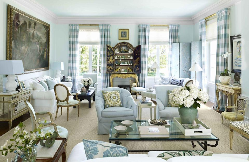 """<p>At a Palladian-style home in Palm Beach, the breezy living room's ceiling and walls are painted a pale aquamarine color, a custom shade from <a href=""""https://donaldkaufmancolor.com"""" rel=""""nofollow noopener"""" target=""""_blank"""" data-ylk=""""slk:Donald Kaufman Color"""" class=""""link rapid-noclick-resp"""">Donald Kaufman Color</a>. Grounding the space is a sisal rug by <a href=""""https://www.starkcarpet.com"""" rel=""""nofollow noopener"""" target=""""_blank"""" data-ylk=""""slk:Stark"""" class=""""link rapid-noclick-resp"""">Stark</a>.</p>"""