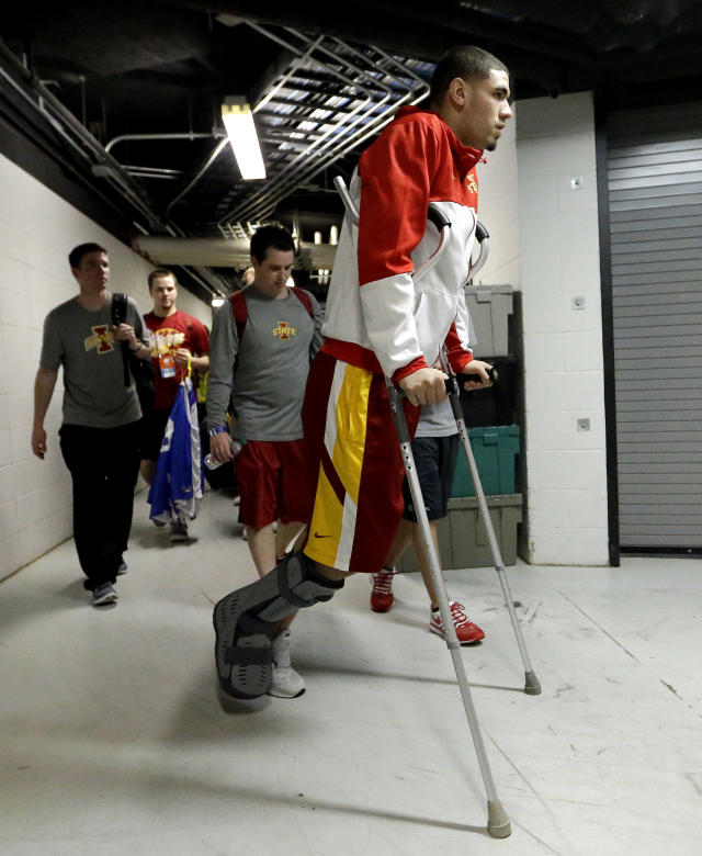 Iowa State's Georges Niang arrives at the AT&T Center using crutches for an NCAA college basketball tournament practice Saturday, March 22, 2014, in San Antonio. Niang, who broke his foot during Friday's game against North Carolina Central, with not play when Iowa State plays North Carolina Sunday. (AP Photo/David J. Phillip)