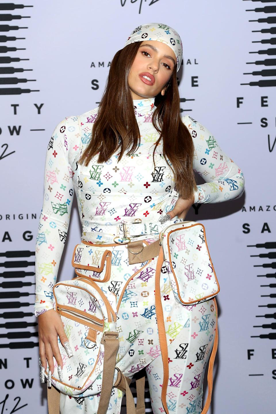 <p>Rosalía styled her hair with a printed headscarf that matched her outfit and made her lips pop with a soft pink-beige lipstick.</p>