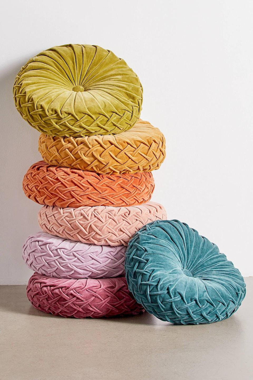 """<p>We want this <a href=""""https://www.popsugar.com/buy/Round-Pintuck-Pillow-555106?p_name=Round%20Pintuck%20Pillow&retailer=urbanoutfitters.com&pid=555106&price=29&evar1=casa%3Aus&evar9=45186448&evar98=https%3A%2F%2Fwww.popsugar.com%2Fhome%2Fphoto-gallery%2F45186448%2Fimage%2F47349986%2FRound-Pintuck-Pillow&list1=shopping%2Curban%20outfitters%2Chome%20decor%2Csmall%20space%20living%2Cdecor%20shopping&prop13=mobile&pdata=1"""" class=""""link rapid-noclick-resp"""" rel=""""nofollow noopener"""" target=""""_blank"""" data-ylk=""""slk:Round Pintuck Pillow"""">Round Pintuck Pillow</a> ($29, originally $39) in every color.</p>"""