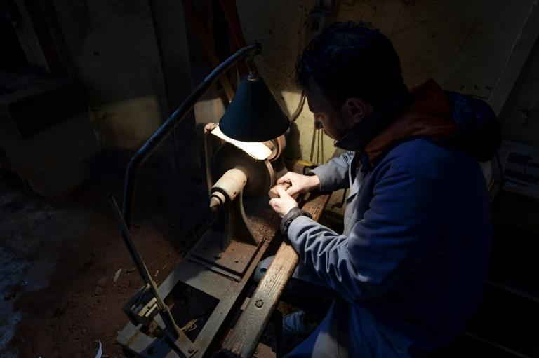 Anis Bouchnak carves a wood pipe at his workshop in the Tunisian coastal town of Tabarka, a craft passed down by his grandfather and father