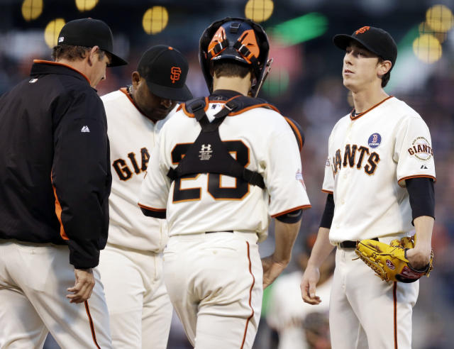 San Francisco Giants starting pitcher Tim Lincecum, right, gets a visit to the mound from pitching coach Dave Righetti, left, third baseman Pablo Sandoval and catcher Buster Posey (28) after allowing a run on a balk during the second inning of a baseball game against the Boston Red Sox against the Boston Red Sox on Monday, Aug. 19, 2013, in San Francisco. (AP Photo/Marcio Jose Sanchez)