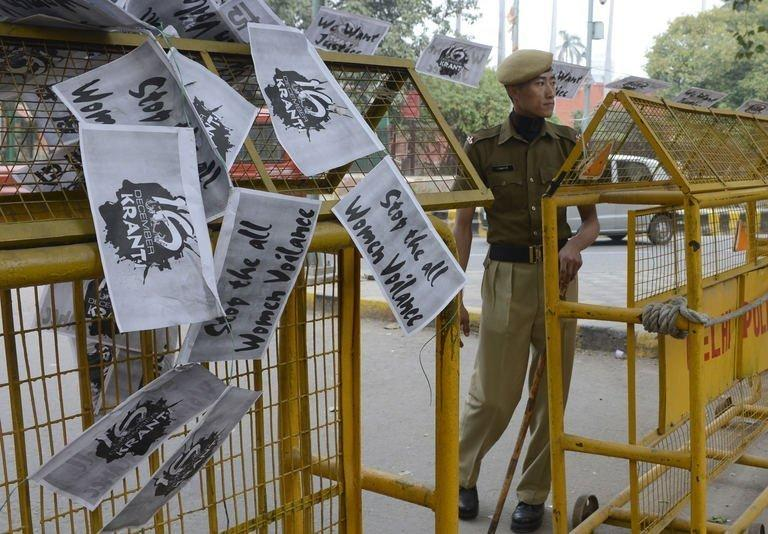 """An Indian police officer looks on near a string of anti-rape posters hung over a police barricade at Janatar Mantar in New Delhi on January 28, 2013. Verdicts for five men accused of the fatal gang-rape of a student on a New Delhi bus would be handed down """"very soon,"""" a defence lawyer has said, as an application to relocate the trial failed"""