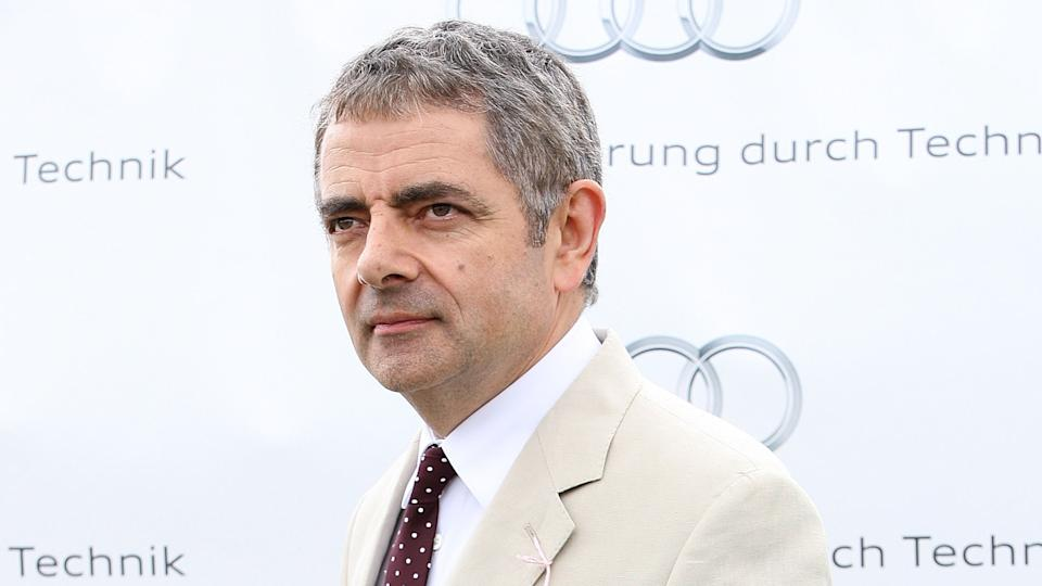 CHICHESTER, ENGLAND - AUGUST 02:  Rowan Atkinson gives an award at ladies day at 'Glorious Goodwood' at Goodwood on August 2, 2012 in Chichester, England.