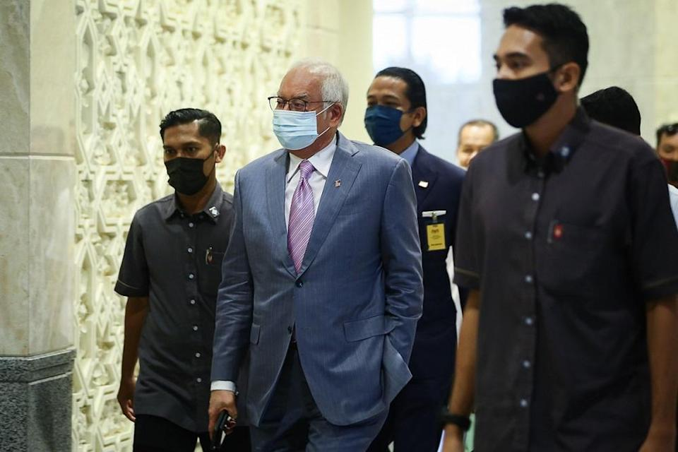 Datuk Seri Najib Razak was sentenced to 10 years' jail on each of the three counts of CBT and each of the three counts of money laundering, and 12 years' jail and a RM210 million fine, in default five years' jail, in the case of abuse of position on July 28 last year. ― Picture by Yusof Mat Isa