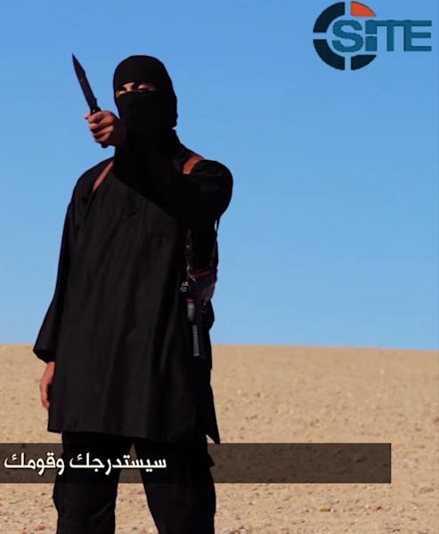 An image grab taken from a video released by the Islamic State group and identified by private terrorism monitor SITE Intelligence Group on September 13, 2014 purportedly shows a masked militant holding a knife (AFP Photo/)