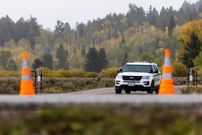 """<div class=""""inline-image__caption""""><p>A park ranger at a roadblock at the entrance of Spread Creek Campground on Sept. 19 near Moran, Wyoming.</p></div> <div class=""""inline-image__credit"""">Natalie Behring/Getty</div>"""