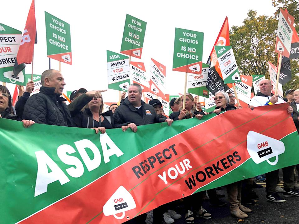 Asda workers marched through Leeds today, to Asda�s headquarters where they handed over a trolley containing a 23,000-strong petition opposing a controversial new contract.