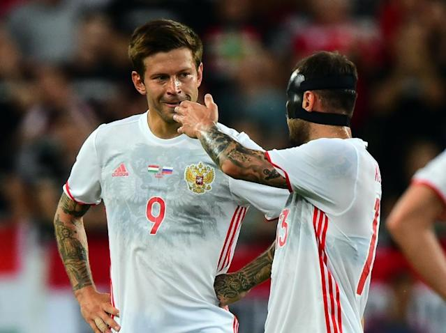 A series of injuries to other players have left Fyodor Smolov as Russia's first-choice striker for the World Cup (AFP Photo/ATTILA KISBENEDEK)