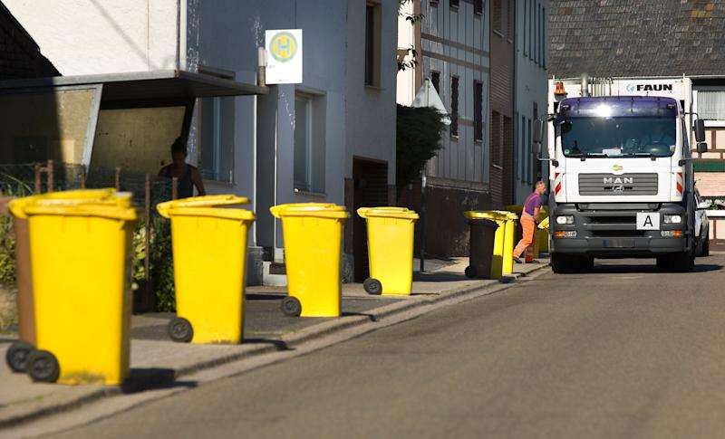 Yellow recycling bins, for packaging, plastic and metal, await collection. (Photo: ullstein bild via Getty Images)