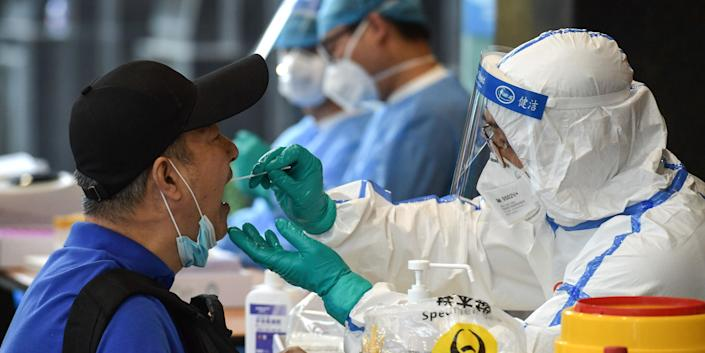 A man, who visited Beijing recently, is tested for the COVID-19 coronavirus in Nanjing in China's eastern Jiangsu province on June 15, 2020. - China's capital city raced on June 15 to control a fresh coronavirus outbreak, with 75 cases linked to a single wholesale food market in Beijing where authorities have locked down neighbourhoods and launched a massive test and trace programme. (Photo by STR / AFP) / China OUT (Photo by STR/AFP via Getty Images)