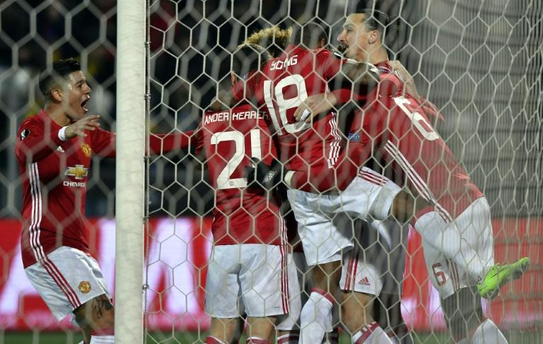 Manchester United players celebrate during their UEFA Europa League round of 16 football match against Rostov at Olimp-2 Arena in Rostov-on-Don on March 9, 2017