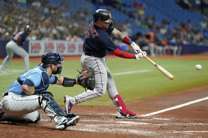 Boston Red Sox's Christian Vazquez lines an RBI single off Tampa Bay Rays' Josh Fleming during the fourth inning of a baseball game Friday, July 30, 2021, in St. Petersburg, Fla. Boston's Xander Bogaerts scored on the play. (AP Photo/Chris O'Meara)
