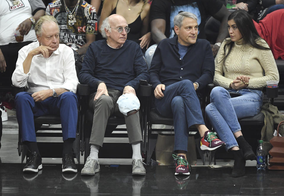 Comedian Larry David (2nd L) and talent agent Ari Emanuel (2nd R), co-CEO of William Morris Endeavor, attends the basketball game between Los Angeles Clippers and Golden State Warriors during Game Six of Round One of the 2019 NBA Playoffs at Staples Center on April 26, 2019 in Los Angeles, California. (Photo by Kevork S. Djansezian/Getty Images)