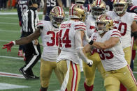 San Francisco 49ers fullback Kyle Juszczyk, center, celebrates his touchdown with teammates Jeff Wilson Jr., left, and George Kittle, right, in the first half of an NFL football game against the New England Patriots, Sunday, Oct. 25, 2020, in Foxborough, Mass. (AP Photo/Steven Senne)