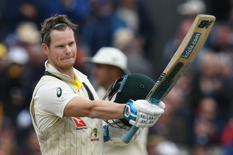 Australia's Steve Smith celebrates making 100 runs on the second day of the fourth Ashes cricket Test match between England and Australia at Old Trafford in Manchester, north-west England on September 5, 2019. - (Photo by Paul ELLIS / AFP) / RESTRICTED TO EDITORIAL USE. NO ASSOCIATION WITH DIRECT COMPETITOR OF SPONSOR, PARTNER, OR SUPPLIER OF THE ECB (Photo credit should read PAUL ELLIS/AFP/Getty Images)