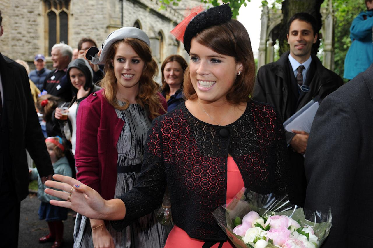 LONDON, ENGLAND - JUNE 03:  Princess Beatrice (L) and Princess Eugenie (R) attend the 'Big Jubilee Lunch' at All Saints Church in Fulham ahead of the Diamond Jubilee River Pageant on June 3, 2012 in London, England. For only the second time in its history the UK celebrates the Diamond Jubilee of a monarch. Her Majesty Queen Elizabeth II celebrates the 60th anniversary of her ascension to the throne. Thousands of well-wishers from around the world have flocked to London to witness the spectacle of the weekend's celebrations. The Queen along with all members of the royal family will participate in a River Pageant with a flotilla of a 1,000 boats accompanying them down The Thames.  (Photo by Matt Grayson - WPA Pool/Getty Images)
