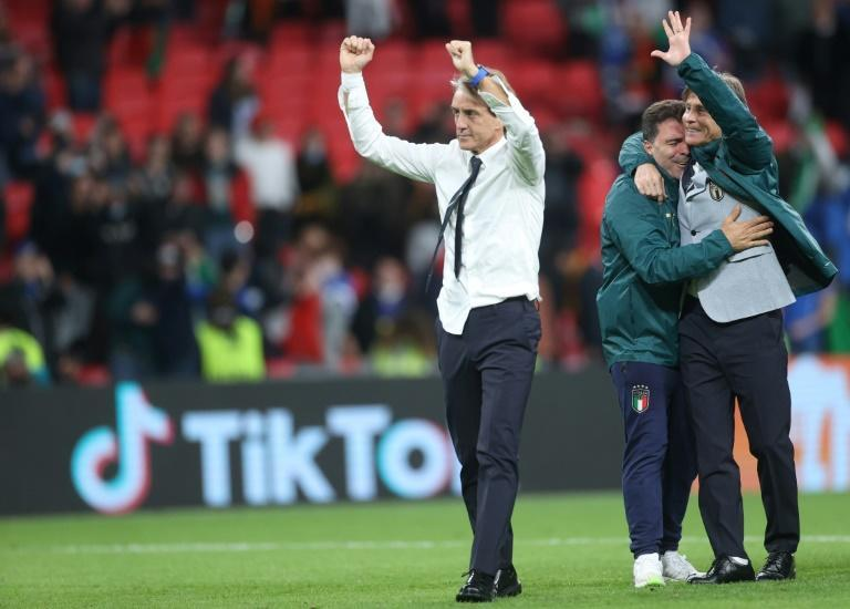 Roberto Mancini celebrates after Italy's penalty shoot-out win over Spain at Wembley