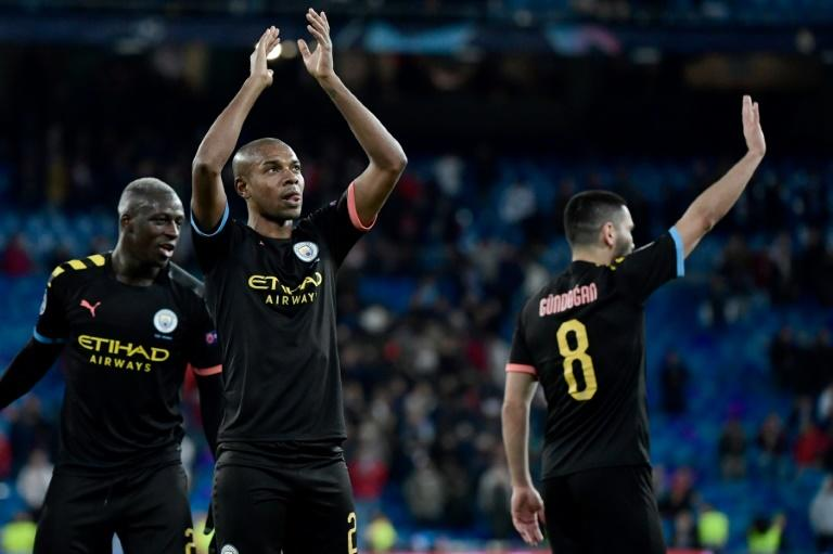 Manchester City player celebrate at the final whistle after beating Real Madrid 2-1