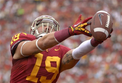 Southern California safety Drew McAllister intercepts a pass in the end zone during the first half of an NCAA college football game against Colorado, Saturday, Oct.20, 2012, in Los Angeles. (AP Photo/Mark J. Terrill)
