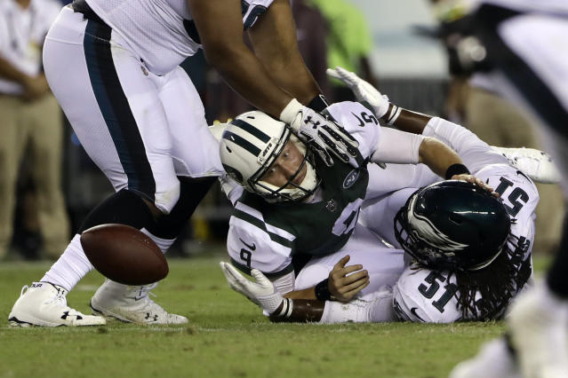 New York Jets' John Wolford (9) fumbles the ball after a tackle by Philadelphia Eagles' Steven Means (51) during the second half of a preseason NFL football game Thursday, Aug. 30, 2018, in Philadelphia. (AP Photo/Matt Rourke)
