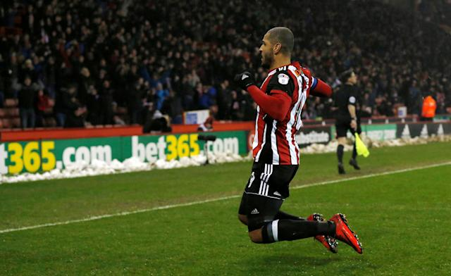 "Soccer Football - Championship - Sheffield United vs Cardiff City - Bramall Lane, Sheffield, Britain - April 2, 2018 Sheffield United's Leon Clarke celebrates scoring their first goal Action Images/Ed Sykes EDITORIAL USE ONLY. No use with unauthorized audio, video, data, fixture lists, club/league logos or ""live"" services. Online in-match use limited to 75 images, no video emulation. No use in betting, games or single club/league/player publications. Please contact your account representative for further details."