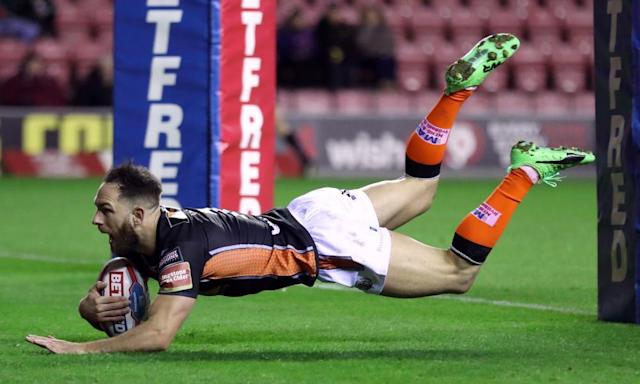 """<span class=""""element-image__caption"""">Castleford Tigers' Luke Gale goes over for a try in the victory over Wigan at the DW Stadium.</span> <span class=""""element-image__credit"""">Photograph: Martin Rickett/PA</span>"""