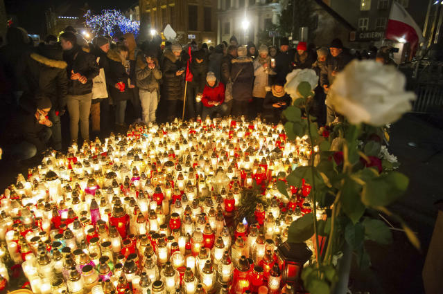 People place candles as they mourn the mayor of Gdansk, Pawel Adamowicz in Gdansk, Poland, Monday, Jan. 14, 2019. The popular liberal mayor of the Polish port city of Gdansk died on Monday from stabbing wounds during a charity event the previous evening by an ex-convict who stormed onstage and said it was revenge against the country's main opposition party. (AP Photo/Wojciech Strozyk)