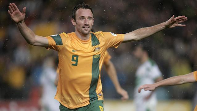 FILE - In this June 18, 2013, file photo, Australia's Josh Kennedy celebrates after scoring against Iraq during their World Cup soccer Asian qualifying match at the Sydney Olympic Stadium in Sydney, Australia. Australia won the match 1-0 and qualify for the 2014 World Cup in Brazil. (AP Photo/Rick Rycroft, File)