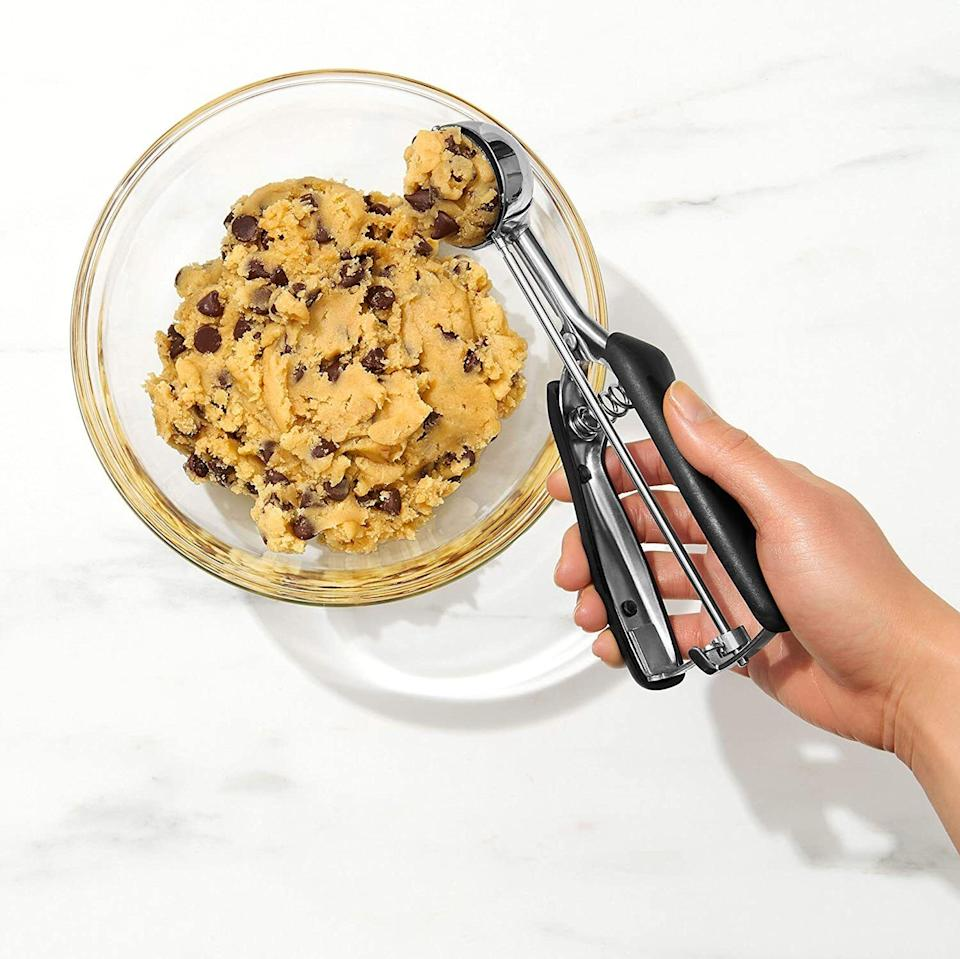 """All of your precious balls of dough will come out *exactly* the same and look simply stunning before everyone in the house gobbles 'em up.<br /><br /><strong>Promising review:</strong>""""Why didn't I have one of these in my kitchen drawer before?! I bought the medium-sized scoop originally to make a large batch of cookies for Christmas, but today it came handy when I had leftover batter from my banana bread recipe and it made the perfect scoop to fill a regular-sized cupcake liner! Now I'm thinking about getting the small size for my mini-cupcakes!<strong>Super easy and they came out perfectly uniform and totally beats trying to use a spoon!</strong>Handles have a nice silicone grip too and help with hand fatigue. :-)"""" —<a href=""""https://amzn.to/3sIBN2K"""" target=""""_blank"""" rel=""""noopener noreferrer"""">Michi K<br /></a><br /><strong>Get it from Amazon for<a href=""""https://amzn.to/32Fqq0O"""" target=""""_blank"""" rel=""""noopener noreferrer"""">$13.99+</a>(available in sizes S-L).</strong>"""