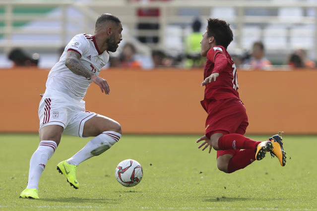 Vietnam's midfielder Nguyen Quang Hai, right, is fouled by Iran's midfielder Ashkan Dejagah during the AFC Asian Cup group D soccer match between Iran and Vietnam at Al Nahyan Stadium in Abu Dhabi, United Arab Emirates, Saturday, Jan. 12, 2019. (AP Photo/Kamran Jebreili)