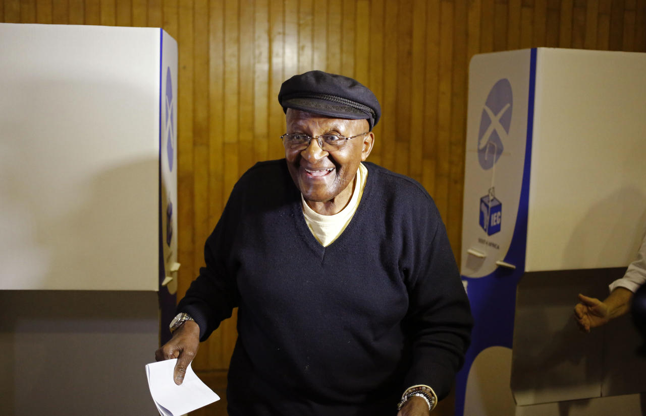 South African Archbishop Desmond Tutu smiles after marking his ballot during elections in Cape Town, South Africa, Wednesday, May 7, 2014. South Africans voted Wednesday in elections that are expected to see the ruling African National Congress return to power despite a vigorous challenge from opposition parties seeking to capitalize on discontent with corruption and economic inequality. (AP Photo/Schalk van Zuydam)