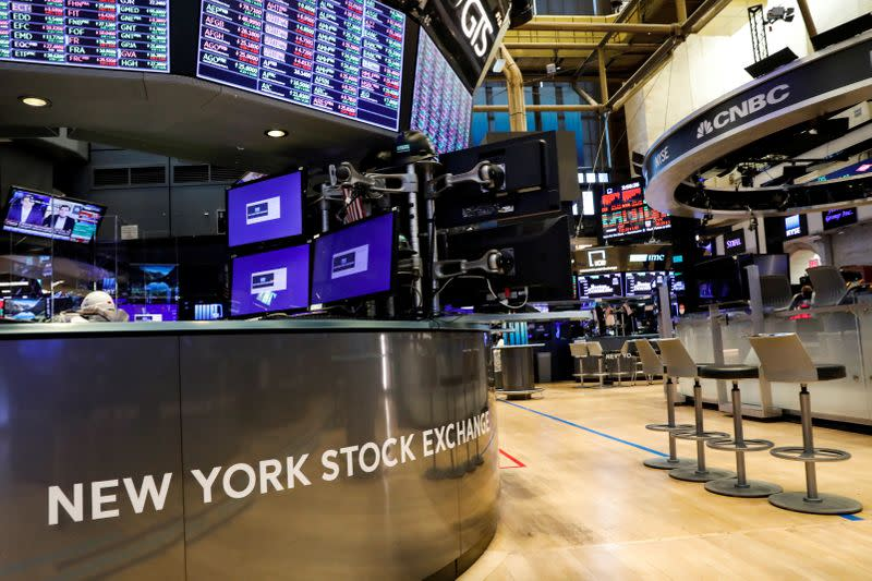 A nearly empty trading floor is seen as preparations are made for the return to trading at the NYSE in New York