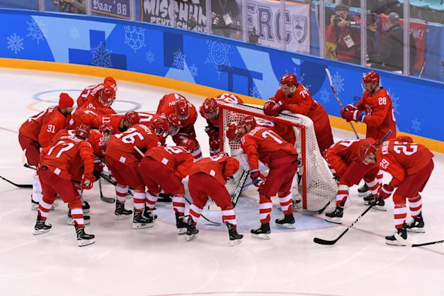 <p>Olympic Athletes from Russia huddle around the net at the start of the game against Germany during the Men's Gold Medal Game on day sixteen of the PyeongChang 2018 Winter Olympic Games at Gangneung Hockey Centre on February 25, 2018 in Gangneung, South Korea. (Photo by Harry How/Getty Images) </p>