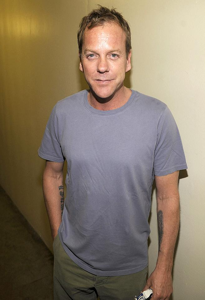 "Kiefer Sutherland's still got a wild side, as his tattoos prove. Kevin Mazur/<a href=""http://www.wireimage.com"" target=""new"">WireImage.com</a> - July 12, 2008"
